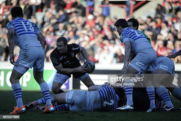 Toulouse's South African scrumhalf Jano Vermaak clears the ball out of a ruck during the European Cup rugby union match Toulouse against Saracens on...