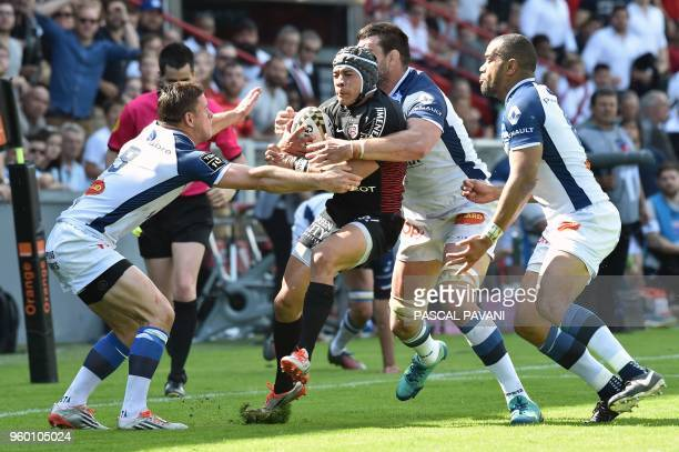 TOPSHOT Toulouse's South African winger Cheslin Kolbe grabs the ball during the French Top 14 rugby union match Toulouse against Castres on May 19...
