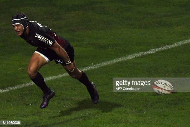 Toulouse's South African winger Cheslin Kolbe scores a try during the French Top 14 rugby union match Toulouse v Pau at The Ernest Wallon Stadium in...