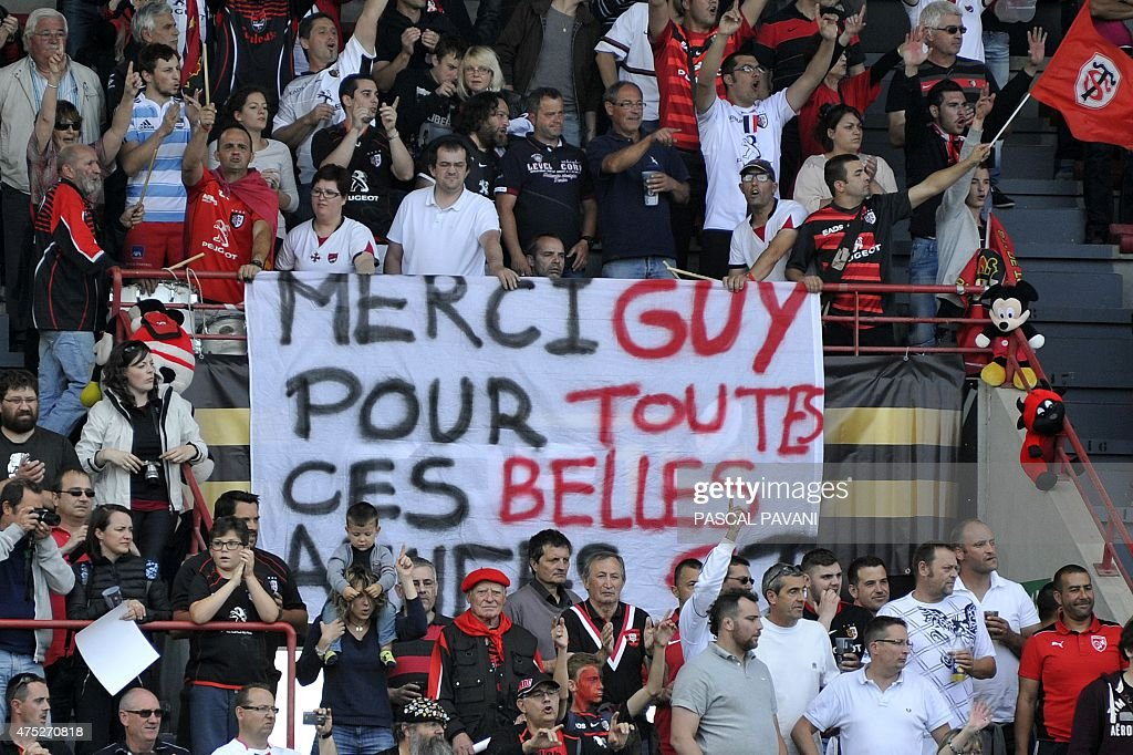 Toulouse's supporters display a banner reading in French 'Thank you Guy for all those beautiful years' at the end of the French Top 14 rugby union match between Toulouse and Oyonnax on May 30, 2015 at the Ernest Wallon Stadium in Toulouse, southern France.
