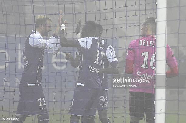 Toulouse's Swedish forward Ola Toivonen celebrates with his teammates after scoring a goal during the French L1 football match between Toulouse and...