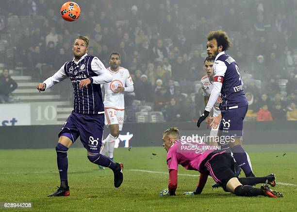 Toulouse's Swedish forward Ola Toivonen eyes the ball before scoring a goal during the French L1 football match between Toulouse and Lorient December...