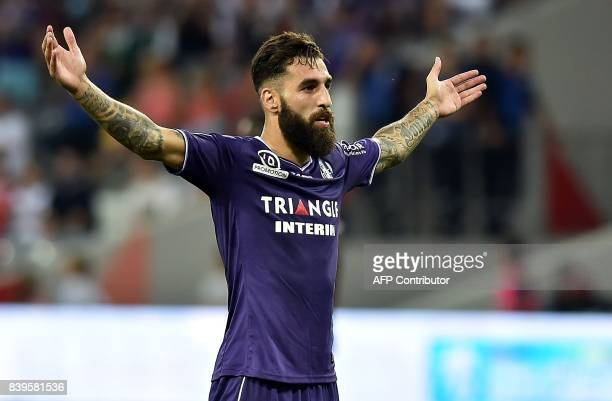 Toulouse's Swedish midfielder Jimmy Durmaz celebrates after he scored a goal during the French L1 football match Toulouse vs Rennes at The Municipal...