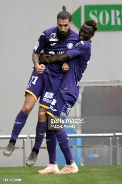 Toulouse's Swedish midfielder Jimmy Durmaz celebrates with teamate after scoring a goal during the French L1 football match between Toulouse and...