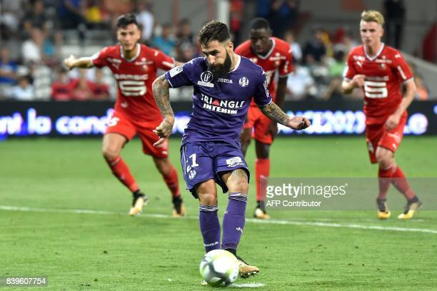 Toulouse's Swedish midfielder Jimmy Durmaz takes a second penalty kick during the French L1 football match between Toulouse and Rennes at the...