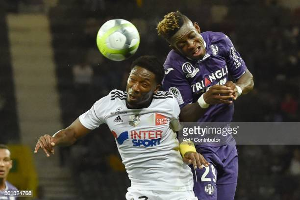 Toulouse's Swiss defender Francois Moubandje vies with Amiens' French midfielder Serge Gakpe during the French L1 football match Toulouse against...