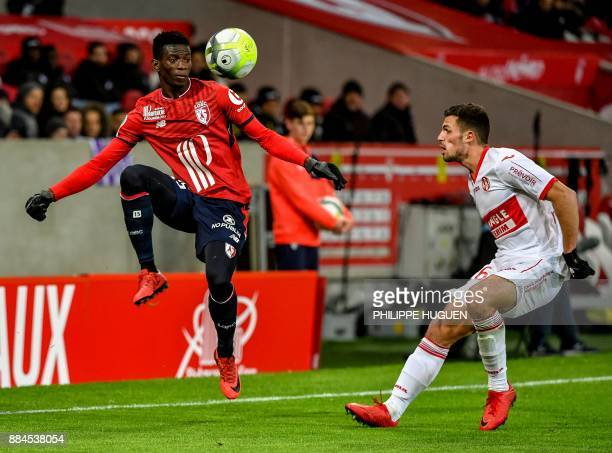 Toulouse's Swiss defender Francois Moubandje vies with Lille's Portuguese defender Edgar Ie during the French L1 football match between Lille and...