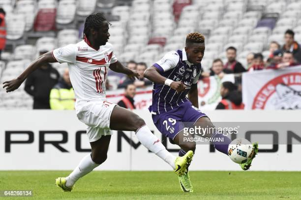Toulouse's Swiss defender Jacques Francois Moubandje vies with Lille's Portuguese forward Eder during the French L1 football match between Toulouse...
