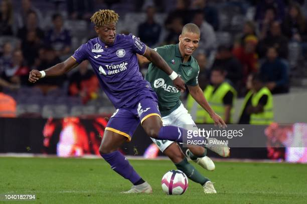 Toulouse's Swiss defender Jacques François Moubandje vies with SaintEtienne's French forward Kevin MonnetPaquet during the French L1 football match...