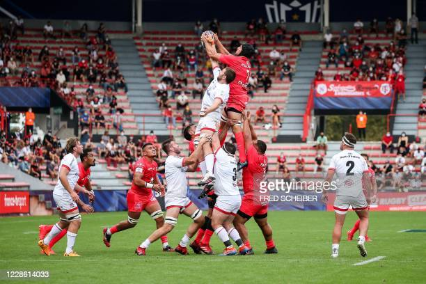 Toulouses team-players and Ulster's team-players fight for the ball in a line out during the European Champions Cup quarter-final rugby union match...