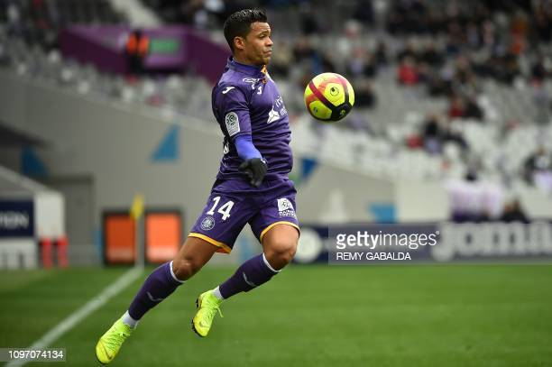 Toulouse's Togolese midfielder Mathieu Dossevi controls the ball during the French L1 football match between Toulouse Football Club and Stade de...