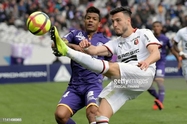 Toulouse's Togolese midfielder Mathieu Dossevi vies with Rennes Algerian defender Ramy Bensebaini during the French L1 football match between...
