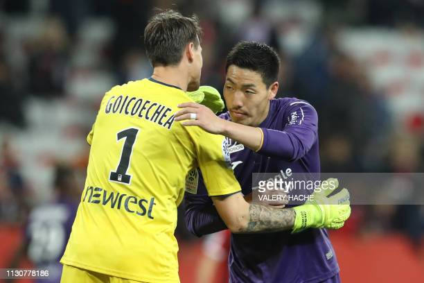 Toulouse's Uruguayan goalkepper Mauro Goicoechea and Toulouse's Japan defender Gen Shoji greet each other at the end of the French L1 football match...