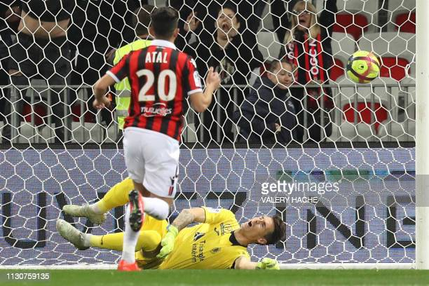 Toulouse's Uruguayan goalkepper Mauro Goicoechea reacts as he concedes a goal during the French L1 football match between Nice and Toulouse on March...