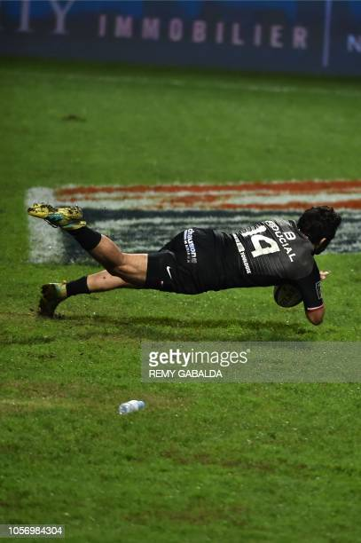 Toulouse's winger Arthur Bonneval scores the first try during the French Top 14 rugby union match between Toulouse and Bordeaux at Ernest Wallon...