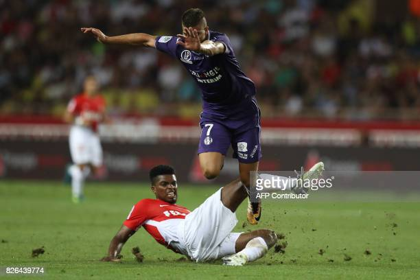 TOPSHOT Toulouse's Zinedine Machach is tackled by Monaco's Brazilian defender Jemerson during the French L1 football match between Monaco and...