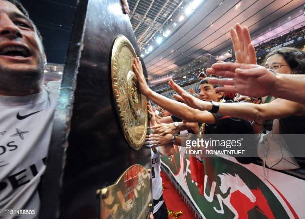 Toulouses's flanker and captain Jean Bouilhou holds the bouclier de Brennus in front of supporters at the end of the French Top 14 rugby union final...