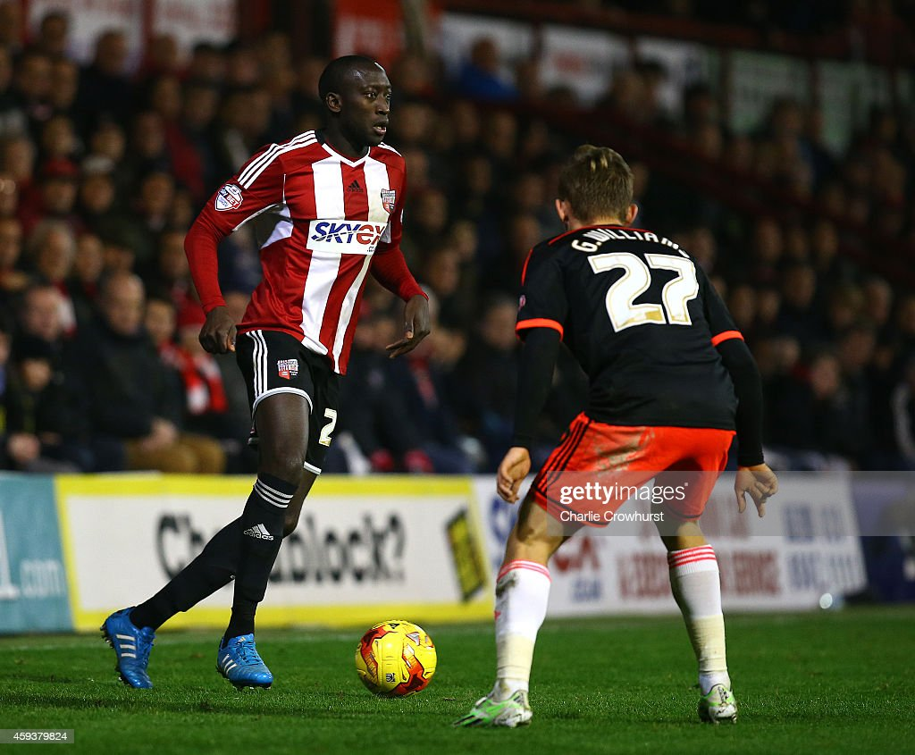 Toumani Diagouraga of Brentford looks to attack during the Sky Bet Championship match between Brentford and Fulham at Griffin Park on November 21, 2014 in Brentford, England,