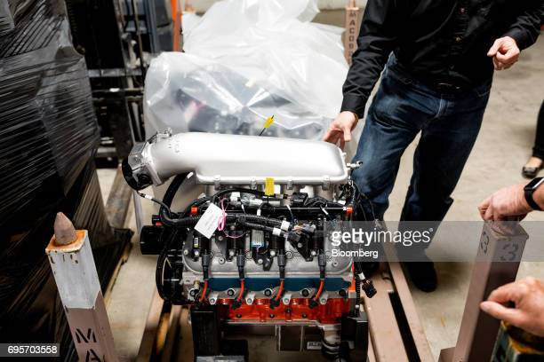 Tour attendees view a General Motors Co Chevrolet COPO Camaro performance engine inside the company's build center in Oxford Michigan US on Friday...