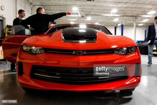 Tour attendees view a General Motors Co Chevrolet COPO Camaro inside the company's build center in Oxford Michigan US on Friday April 21 2017 The...