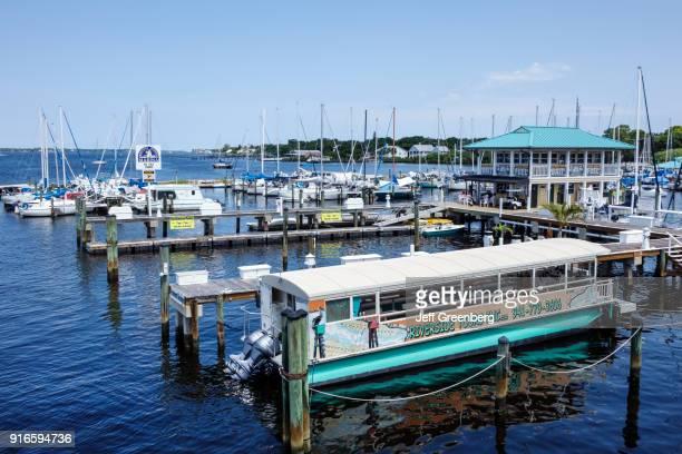 Tour boat docked at Regatta Pointe Marina.