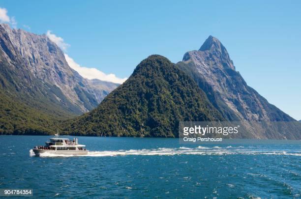 Tour boat in Milford Sound near Mitre Peak.