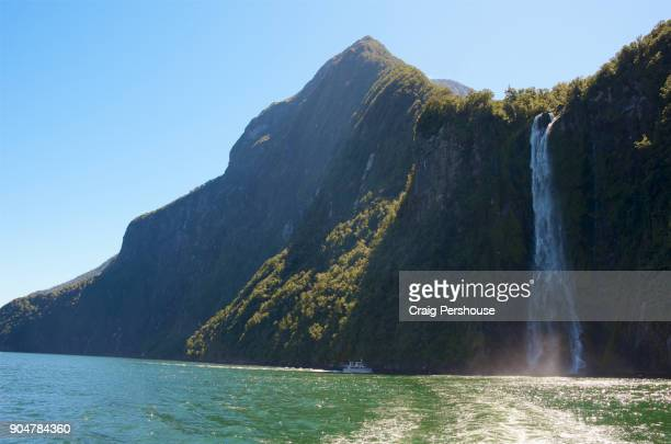 Tour boat in Milford Sound near Stirling Falls.