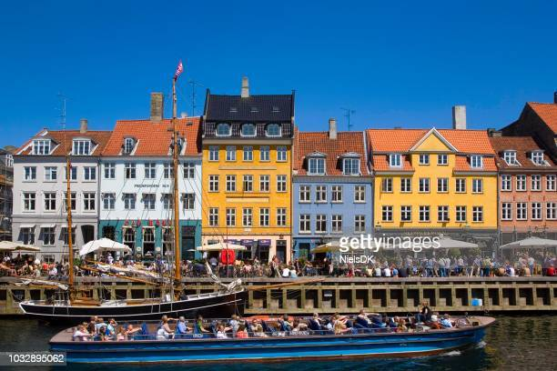 tour boat in nyhavn canal, copenhagen, denmark - nyhavn stock pictures, royalty-free photos & images