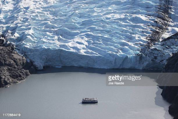 A tour boat is seen near a glaciers terminus in the Kenai Mountains on September 06 2019 near Primrose Alaska Scientists from the US Geological...