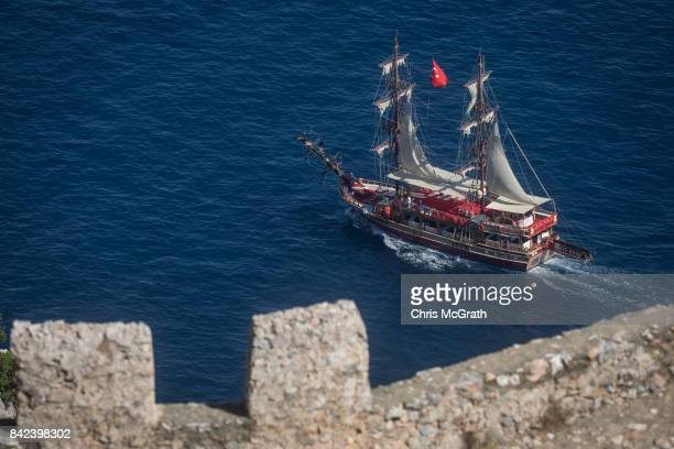 A tour boat is seen passing the ruins of the Alanya Castle on September 3 2017 in Alanya Turkey Turkey's tourism industry spiraled into crisis in...