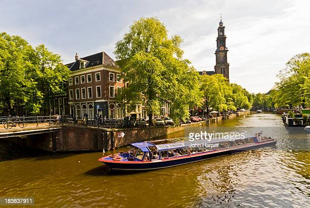 Tour boat on canal, Amsterdam.