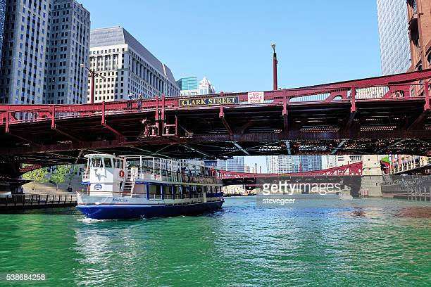 Tour boat on Chicago River passing under  Bridge