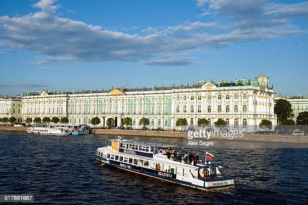 Tour boat on River Neva passing the Winter Palace of the State Hermitage Museum St Petersburg Russia