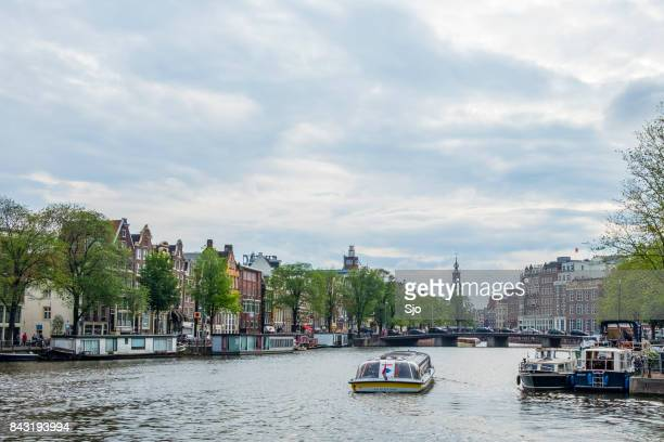 Tour boat on the river Amstel in Amsterdam, the Netherlands