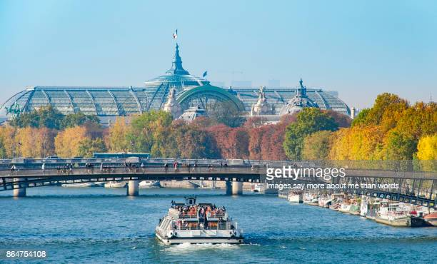 Tour boat sailing the Seine River on a beautiful fall day.
