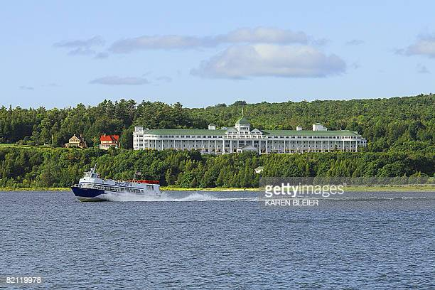 A tour boat speeds past the Grand Hotel on Mackinac Island MI on July 282008 Motorized vehicles have been prohibited on the island since 1898 with...