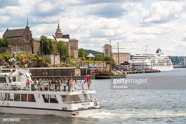 Tour boat with tourists and Cruise ship in Oslo, Norway