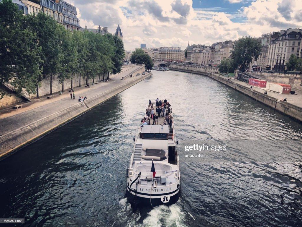 Tour boat with tourists on Seine River, Paris, France : Stock Photo