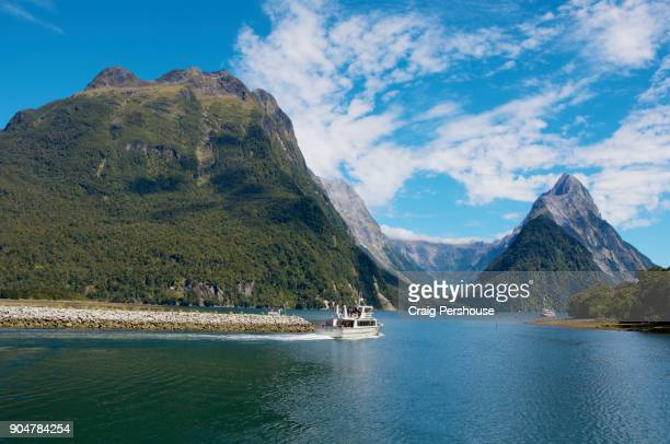 Tour boats in Milford Sound before Mitre Peak and surrounding mountains.