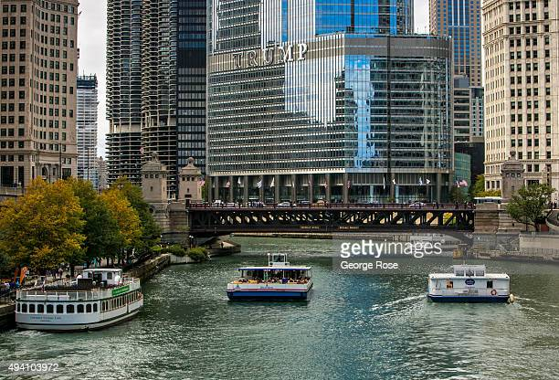 Tour boats motor up the Chicago River toward Trump Tower and past Michigan Avenue on October 9 2015 in Chicago Illinois Chicago the third largest...
