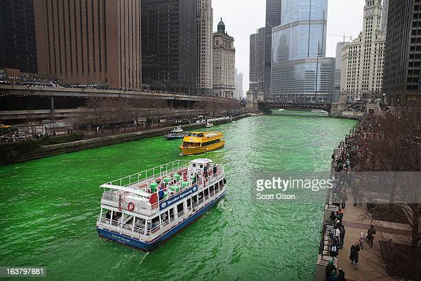 Tour boats travel the Chicago River after workers dyed it green to kick off the city's St Patrick's day celebration on March 16 2013 in Chicago...