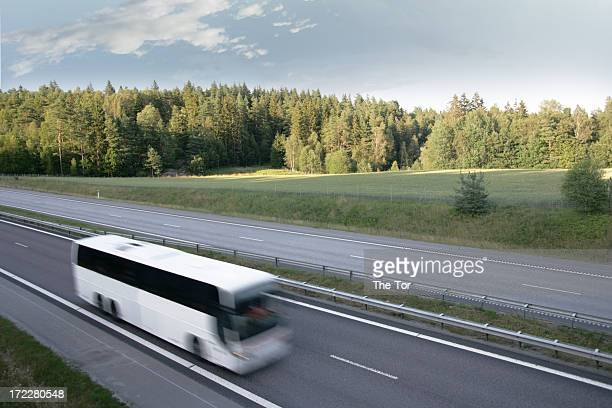 Tour bus in motion on a highway
