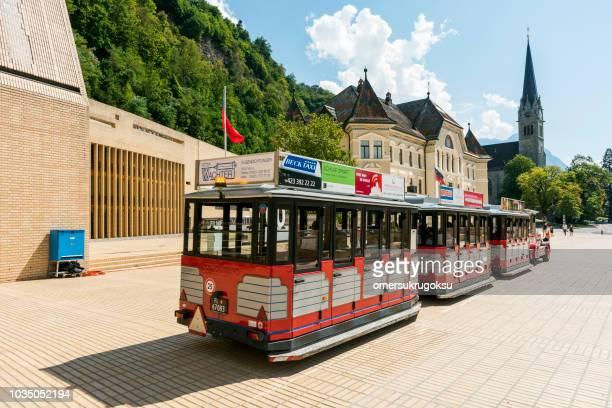 tour bus in vaduz, liechtenstein - principality of liechtenstein stock pictures, royalty-free photos & images