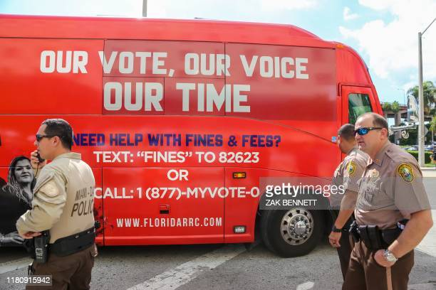 Tour bus, sponsored by the Florida Rights Restoration Coalition, pulls up to a Miami-Dade County courhouse ahead of a special court hearing aimed at...