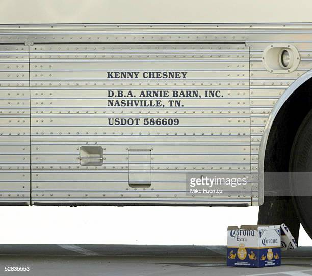 A tour bus with Kenny Chesney's name on it is seen in a parking lot May 14 2005 in Dallas Texas Chesney and actress Renee Zellweger were married last...