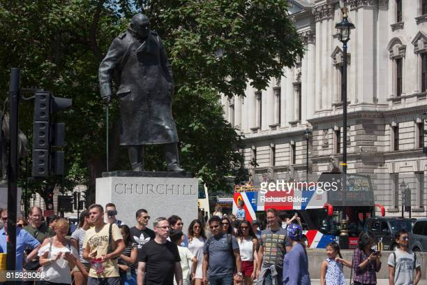 A tour bus with The Original Tour latest branding of a Union jack flag drives past the statue of wartime Prime Minister Winston Churchill on its...