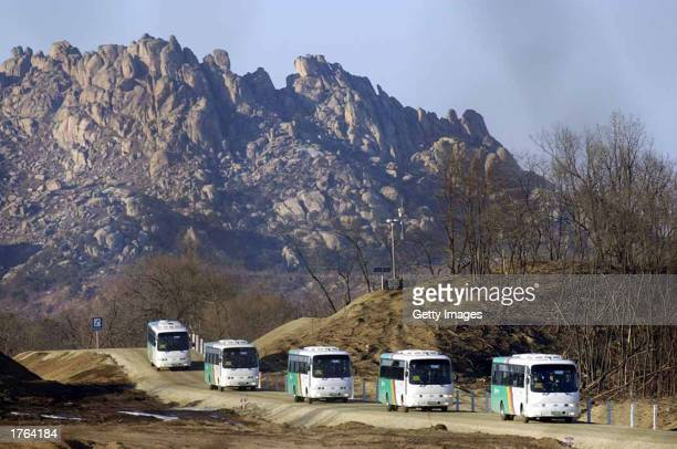 Tour buses carry a South Korean delegation cross into South Korea territory from North Korea at the Demilitarised Zone February 6 2003 at Kosung...