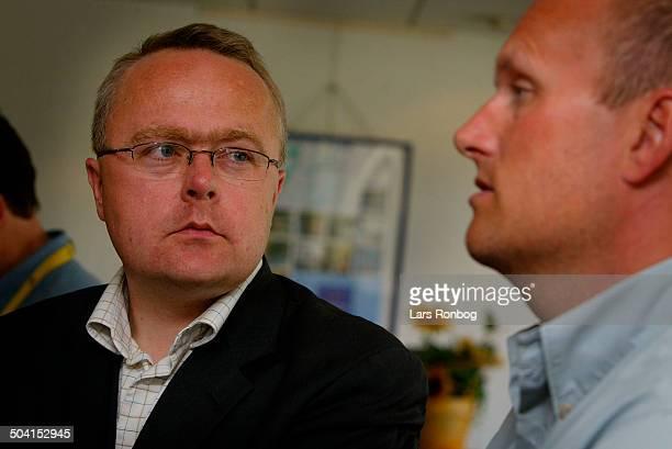 Tour de France 1 Restday Managing Editor Olav Skaaning Andersen DR Sporten listening to Bjarne Riis Team CSC
