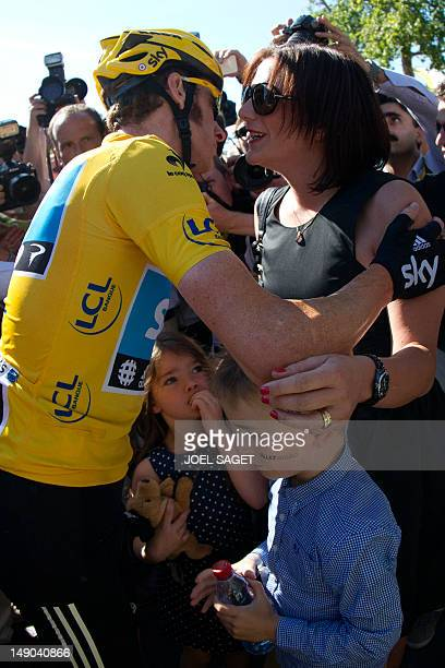 Tour de France 2012 winner Yellow jersey British Bradley Wiggins kisses his wife Catherine flanked by their children on the ChampsElysees Avenue at...