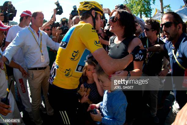 Tour de France 2012 winner Yellow jersey British Bradley Wiggins kisses his wife Catherine flanked by their children and Tour de France director...
